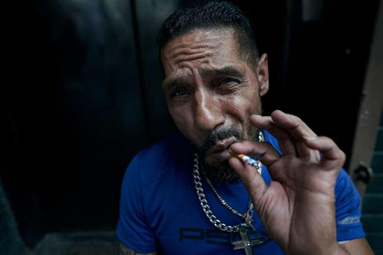 Man in Blue Shirt Smoking